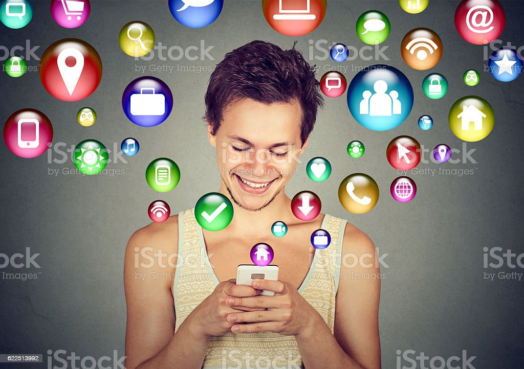 man using smartphone social media application icons flying up stock photo