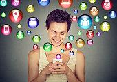 man using smartphone social media application icons flying up
