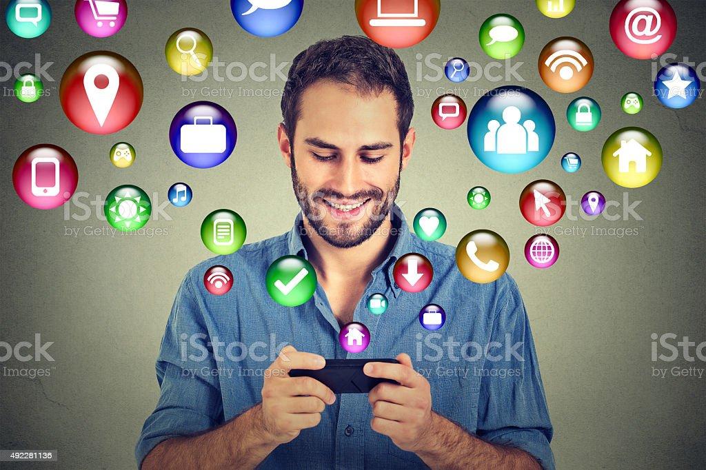 man using smartphone social media application stock photo