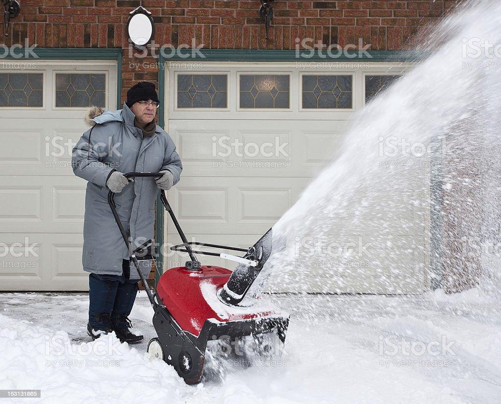 Man Using Snowblower stock photo