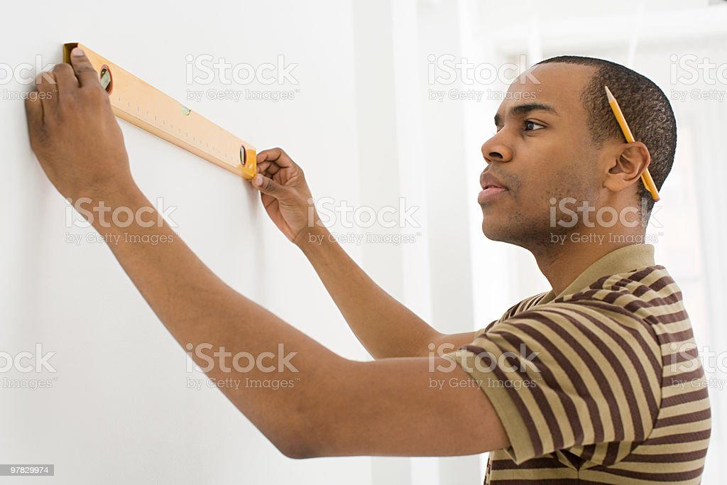 Man using spirit level royalty-free stock photo