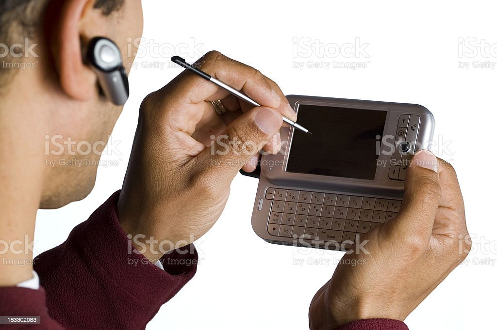 Man Using Stylus on PDA and Wireless Phone royalty-free stock photo
