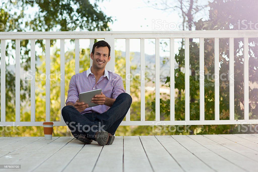 Man using tablet computer outdoors royalty-free stock photo