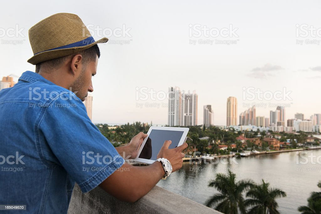 Man Using Tablet in Tropical Miami royalty-free stock photo