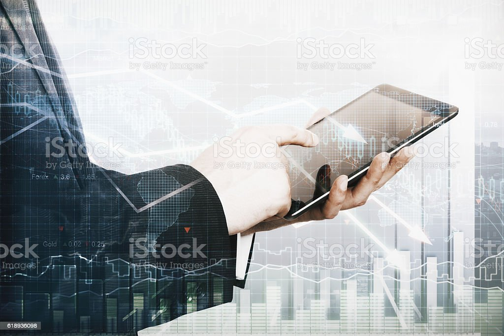 Man using tablet with business charts stock photo