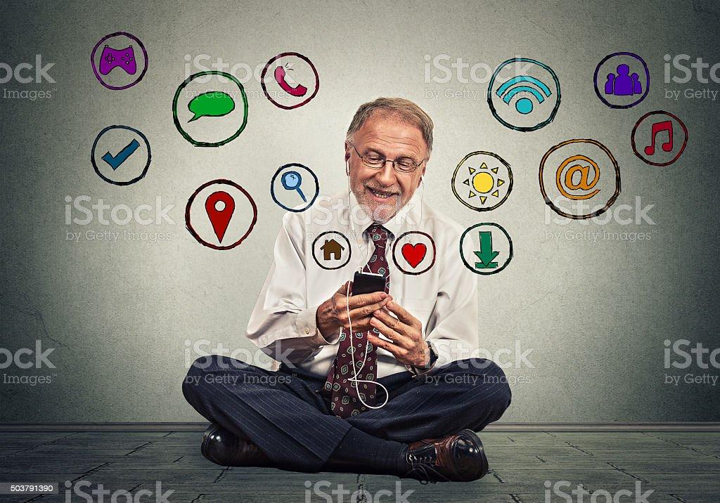 man using texting on smartphone browsing web social media applications stock photo