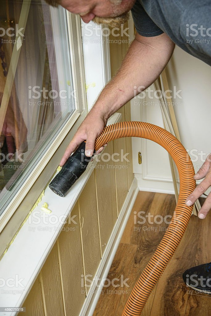 man using vacuum hose stock photo