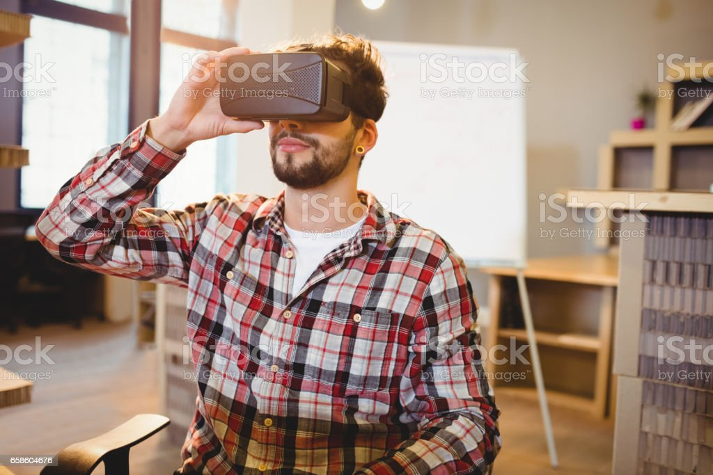 Man using virtual reality headset stock photo