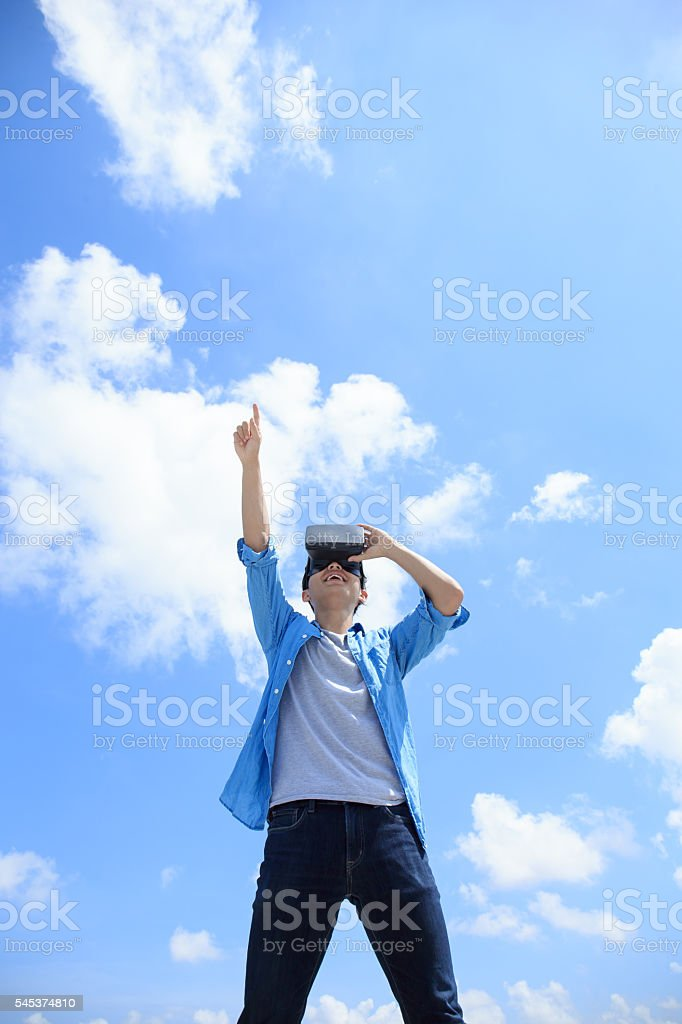 man using VR headset glasses stock photo