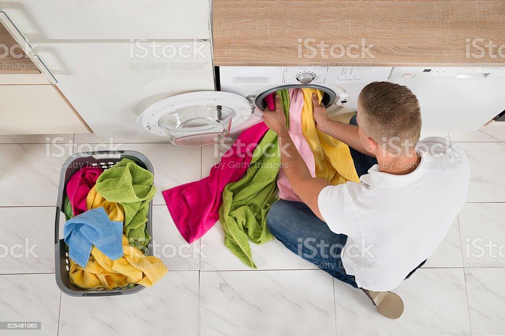 Man Using Washing Machine stock photo