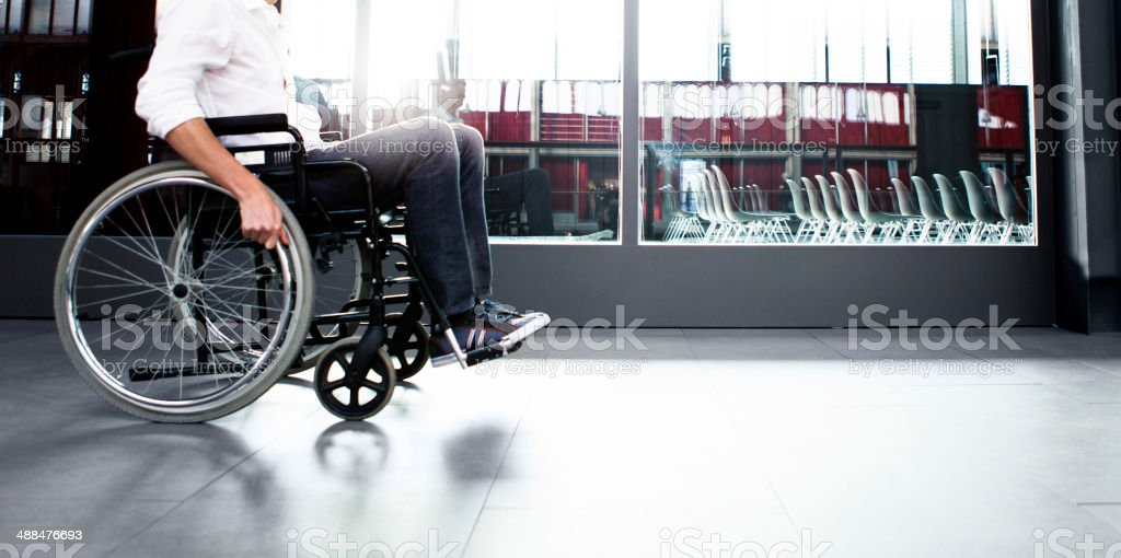 Man using wheel chair stock photo