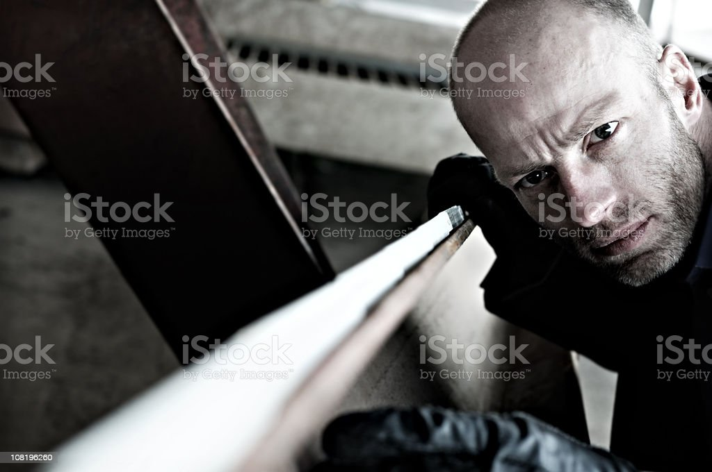 Man Using Yard Stick and Measuring Steel Beam royalty-free stock photo