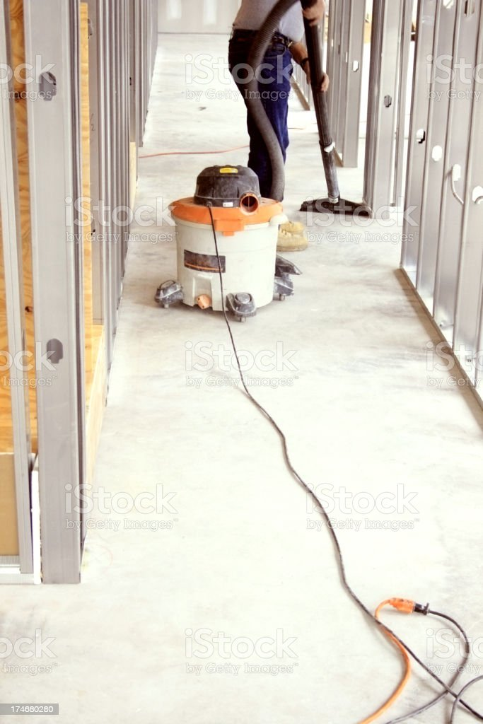 Man Vacuuming a Construction Site stock photo