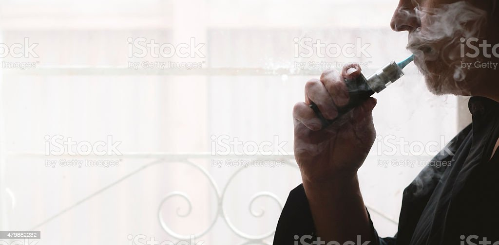 Man Vaping Electronic Cigarette stock photo