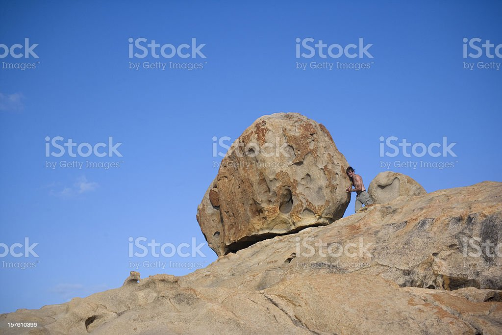 Man Verses Boulder royalty-free stock photo
