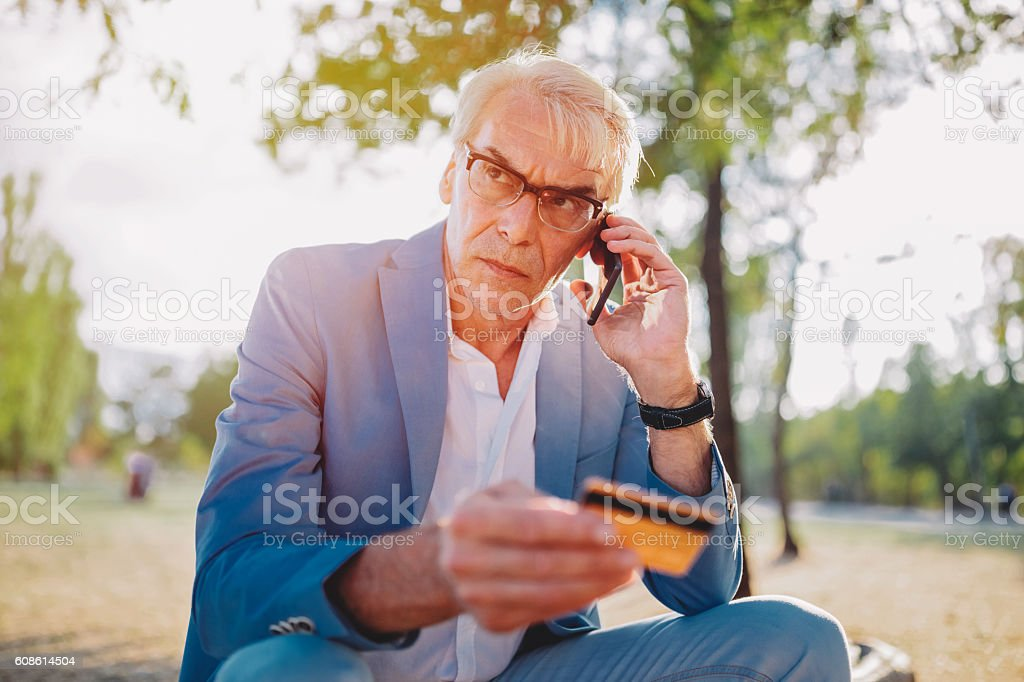 Man victim of credit card fraud stock photo