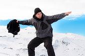 man victory after winter trekking achievement in snow mountain