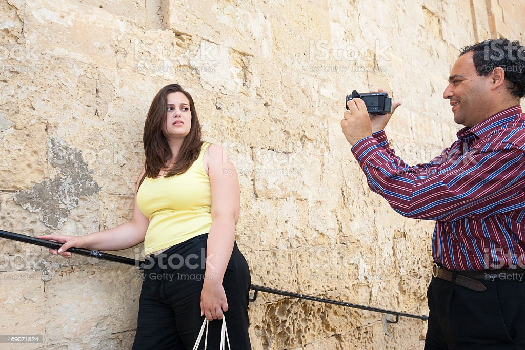 Man Video Tapes Unhappy Woman In Malta stock photo