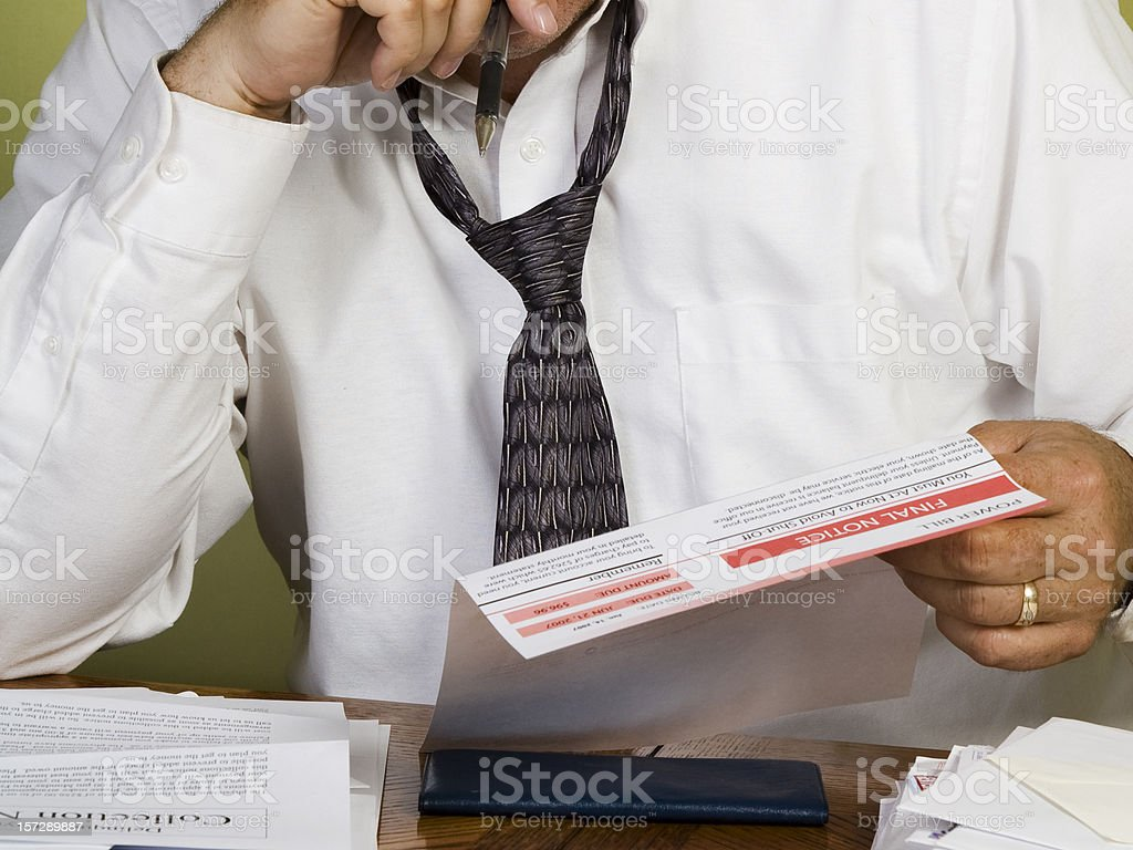 Man Viewing Power Bill Final Notice, Financial Problems. stock photo