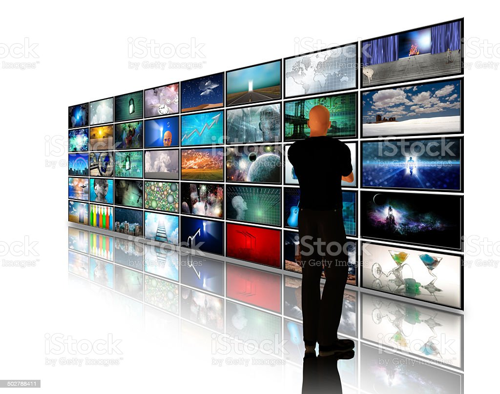 Man viewing video displays stock photo
