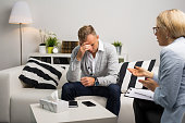 Man visiting doctors office for therapy