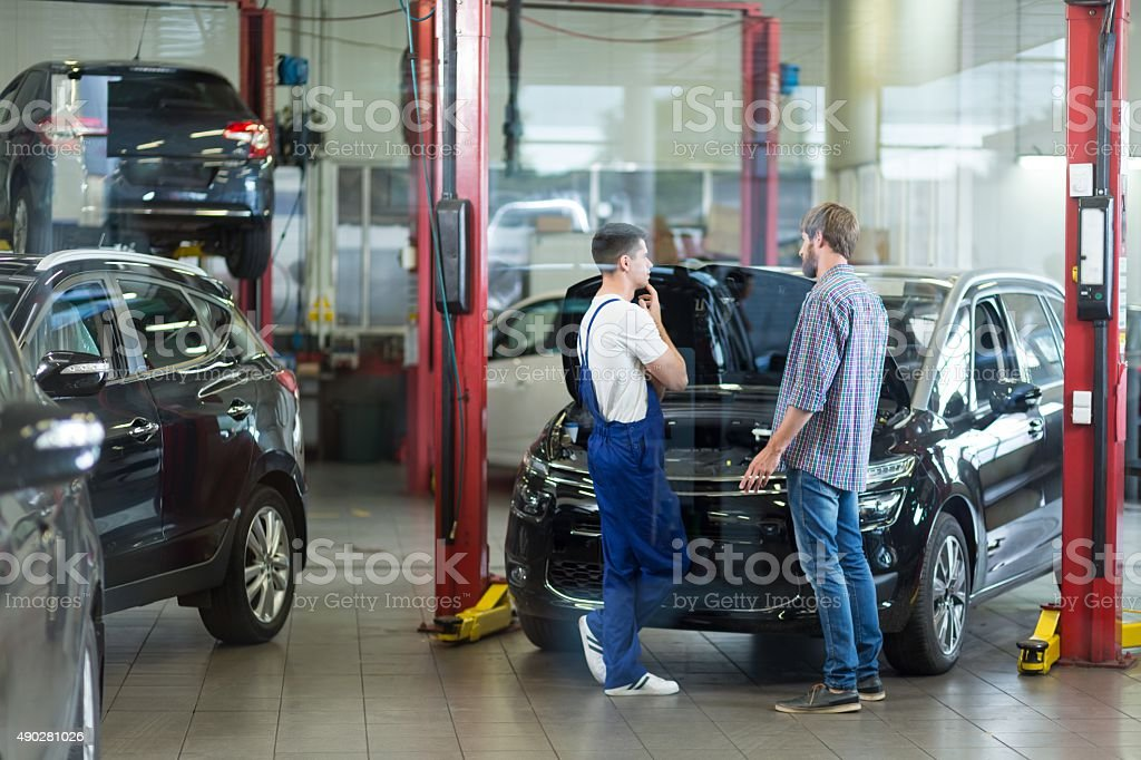 Man visiting repair shop stock photo