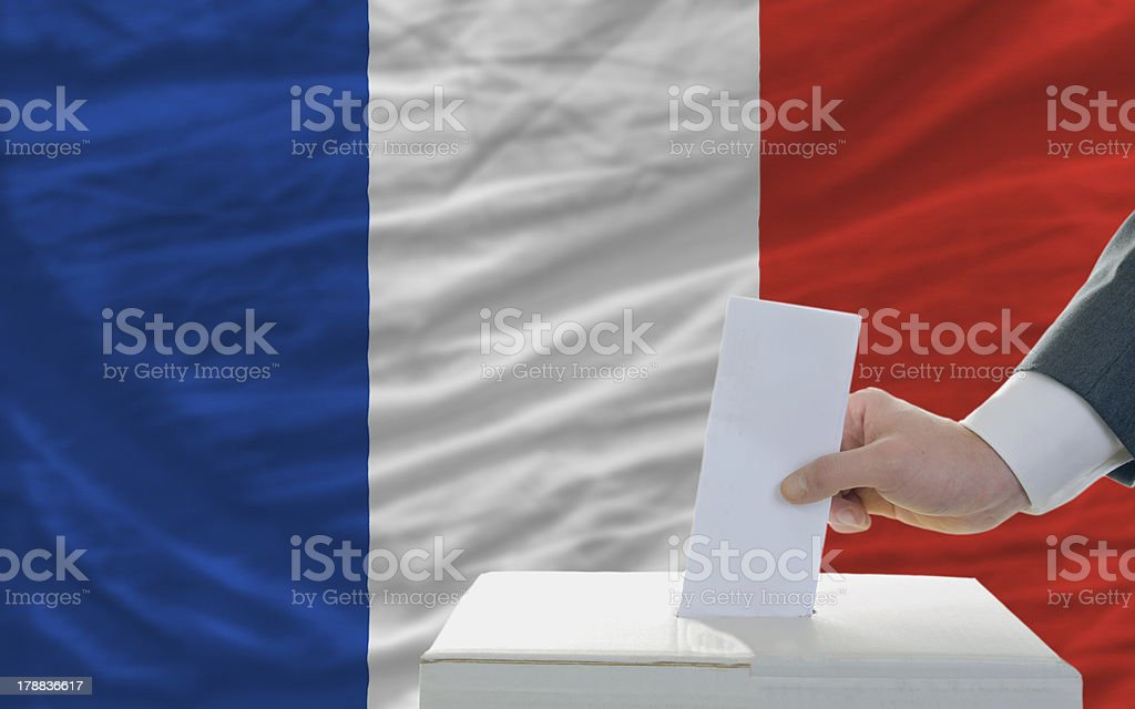 man voting on elections in france stock photo