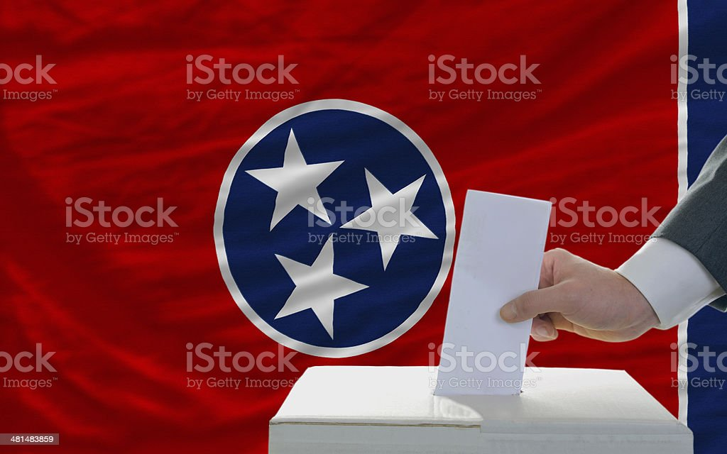 man voting on elections in front  flag of tennesee royalty-free stock photo