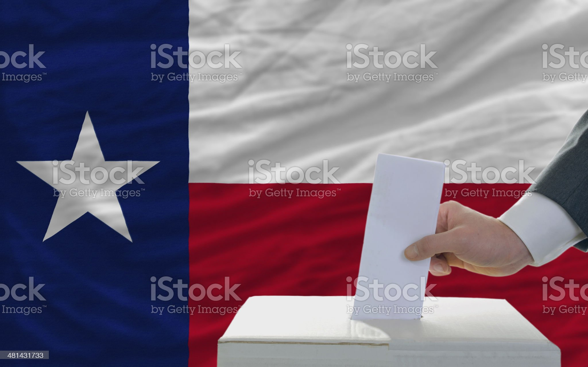 man voting on elections in front flag of texas royalty-free stock photo
