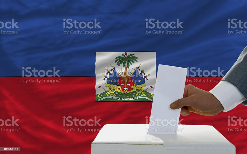 man voting on elections in haiti front of flag royalty-free stock photo