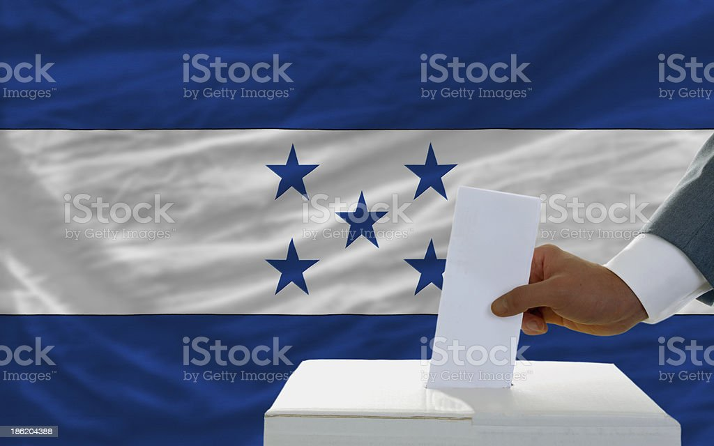 man voting on elections in honduras front of flag royalty-free stock photo
