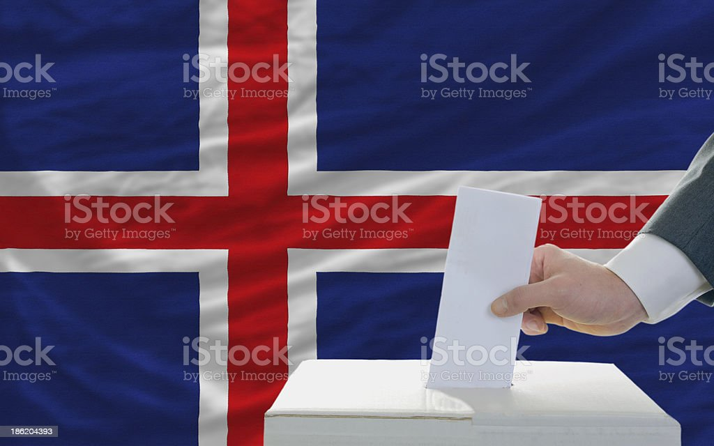 man voting on elections in iceland front of flag royalty-free stock photo