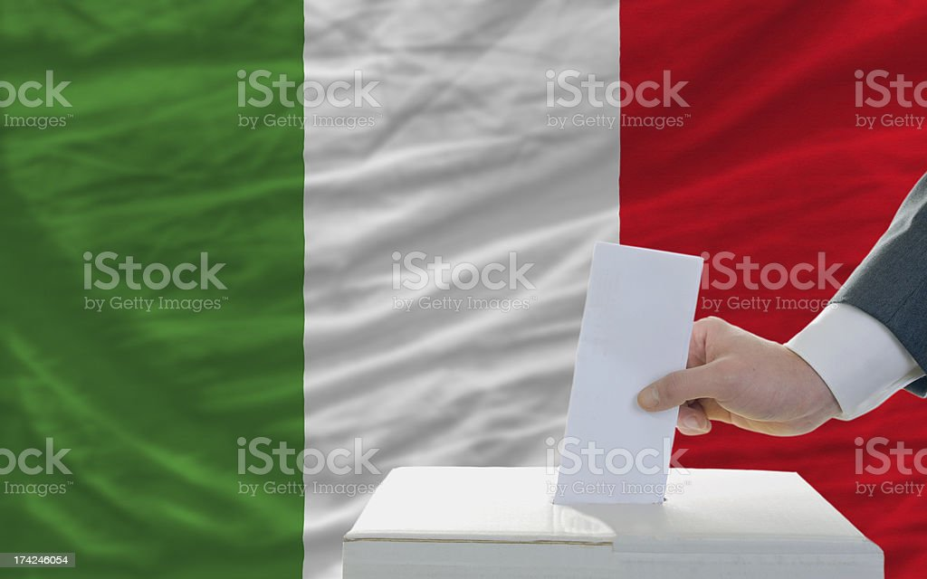 man voting on elections in italy front of flag stock photo