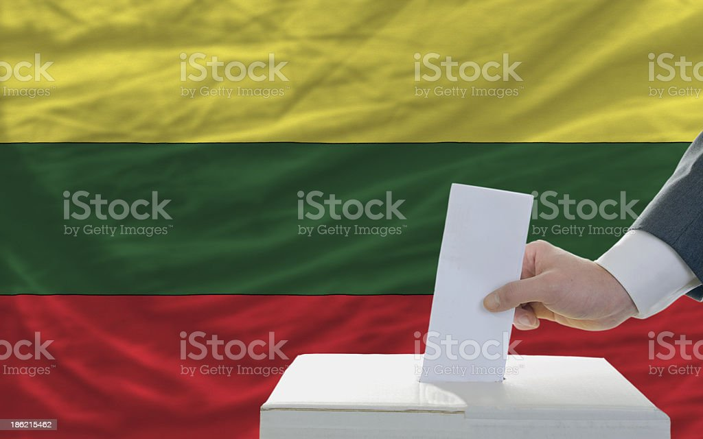 man voting on elections in lithuania front of flag royalty-free stock photo