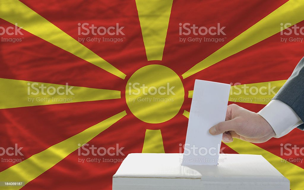man voting on elections in macedonia front of flag royalty-free stock photo