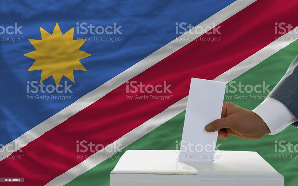 man voting on elections in namibia front of flag royalty-free stock photo