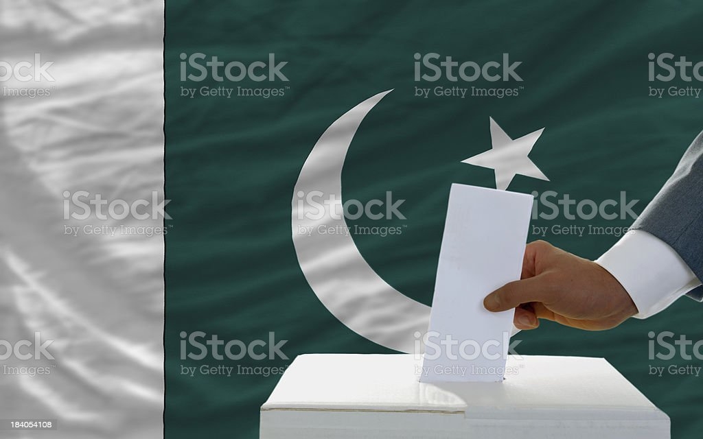man voting on elections in pakistan front of flag royalty-free stock photo