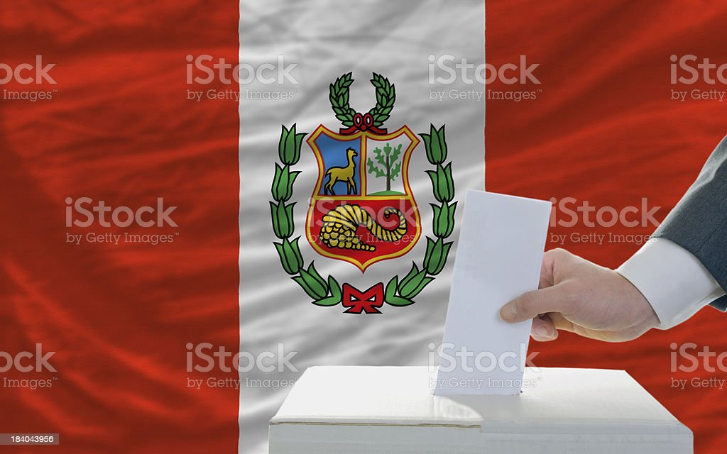 man voting on elections in peru front of flag royalty-free stock photo
