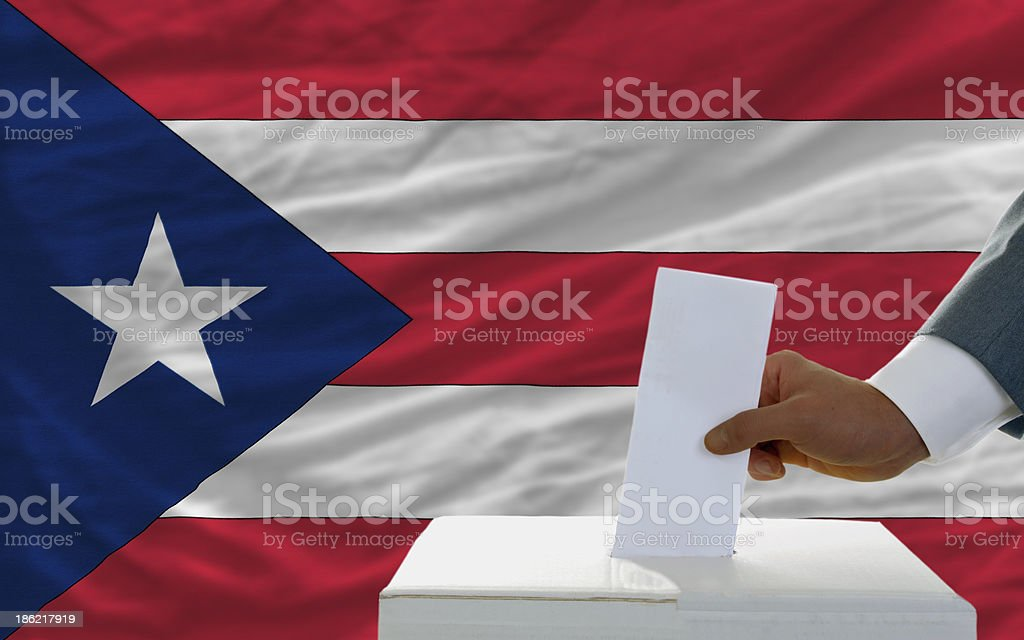 man voting on elections in puerto rico front of flag royalty-free stock photo