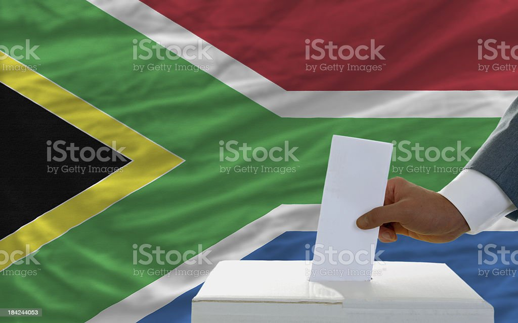 man voting on elections in south africa front of flag royalty-free stock photo