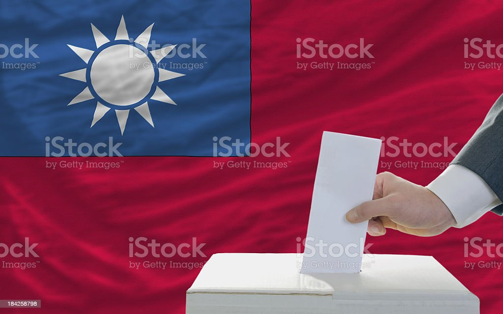 man voting on elections in taiwan front of flag royalty-free stock photo
