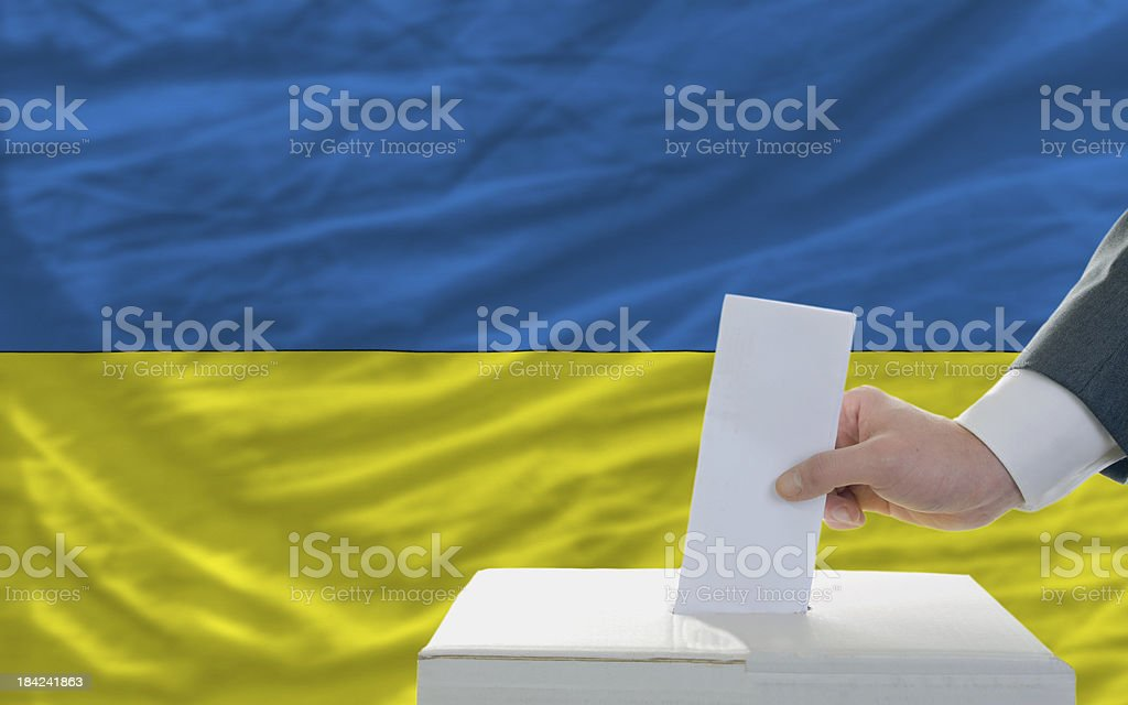 man voting on elections in ukraine front of flag royalty-free stock photo