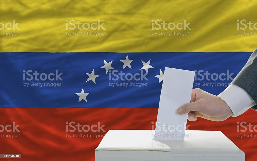 man voting on elections in venezuela front of flag royalty-free stock photo