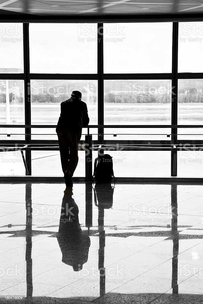 Man waiting for departure of his flight royalty-free stock photo