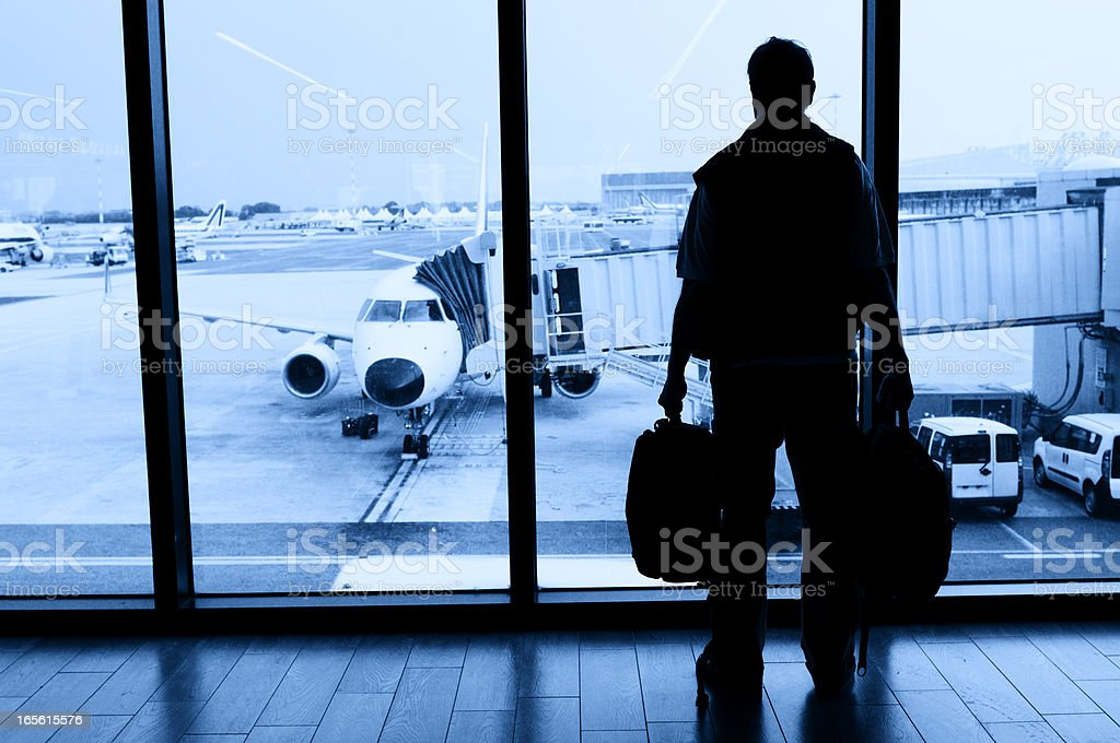 Man Waiting for Flight in Airport Lounge stock photo