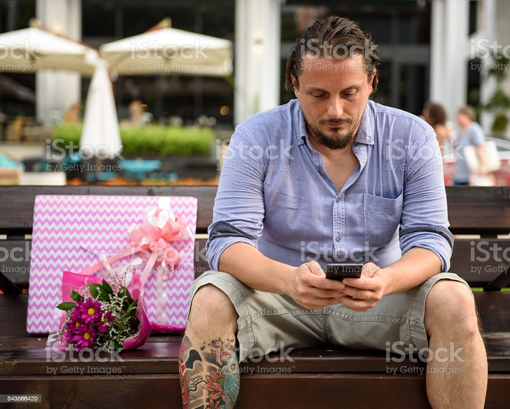Man waiting for his date stock photo