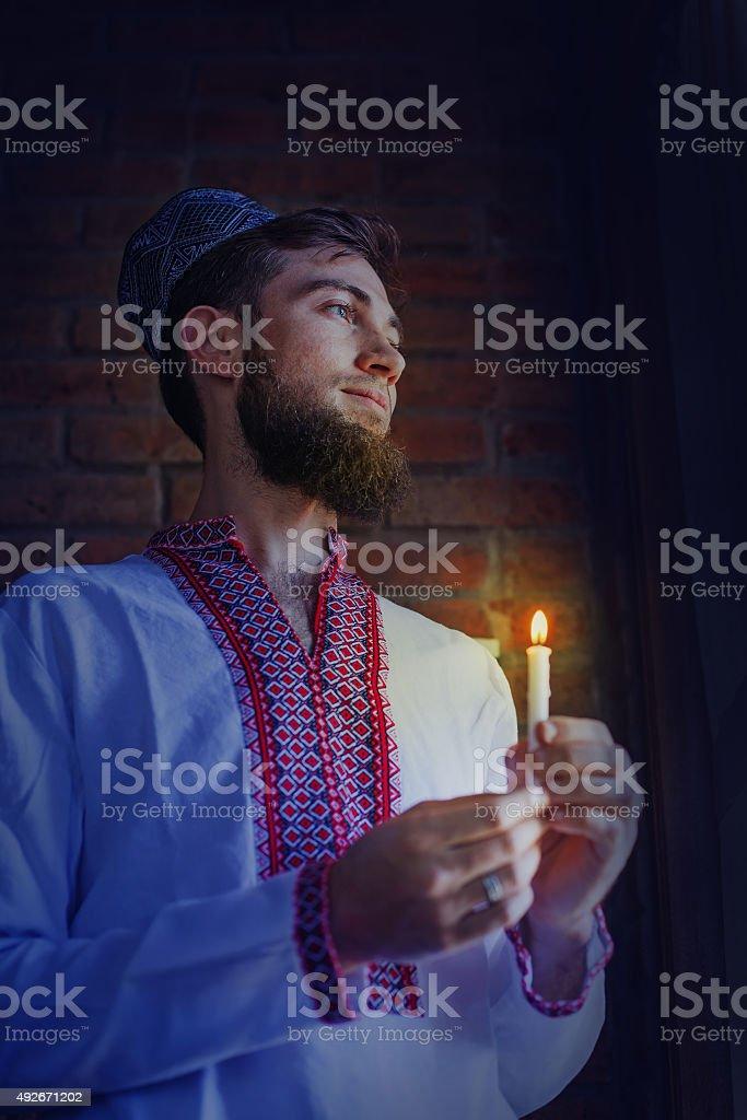 man waiting for sunset in ramadan stock photo