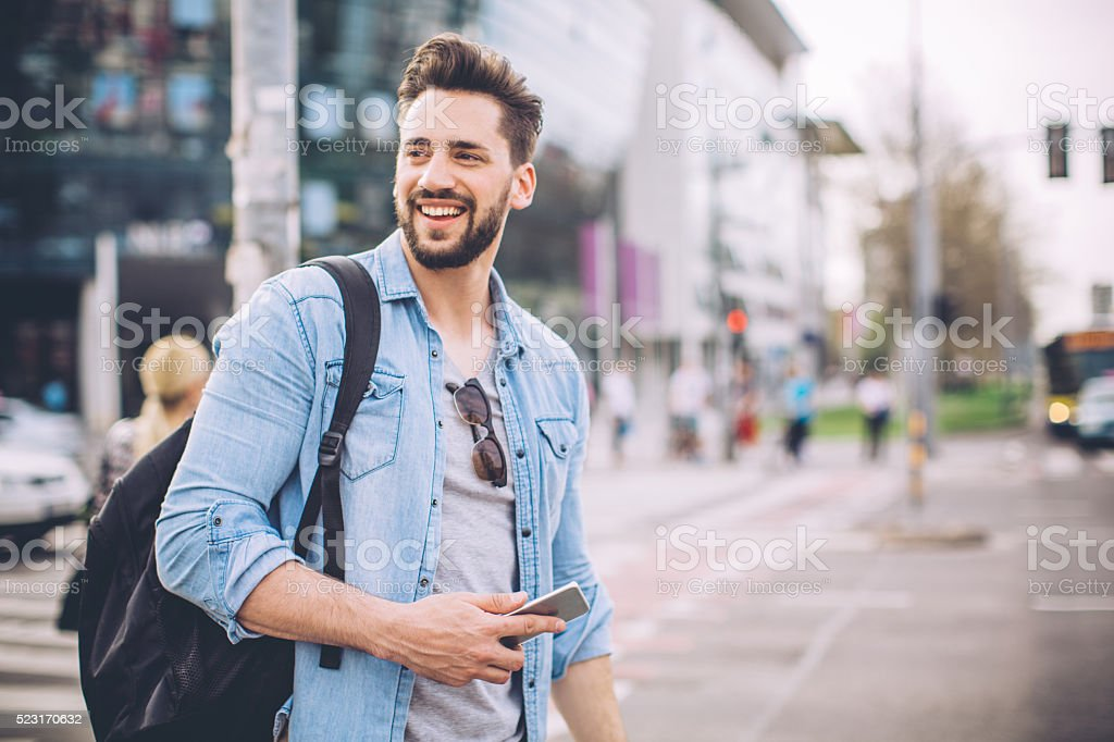 Man waiting for Taxi in the street stock photo