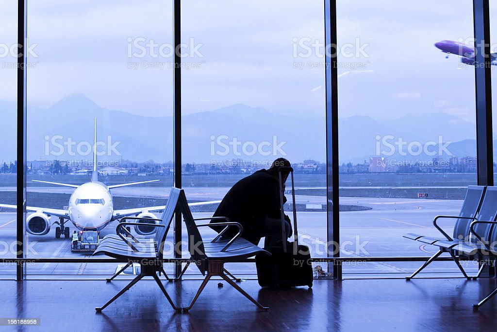 Man Waiting for the Flight in Airport Lobby stock photo