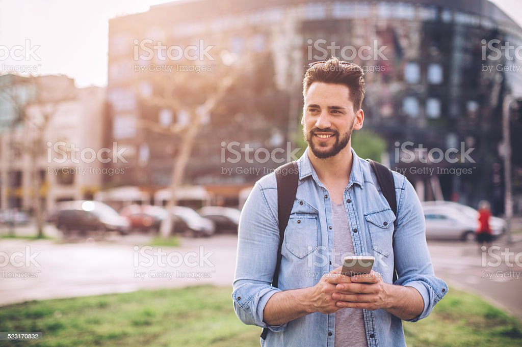 Man waiting for Uber in the street stock photo